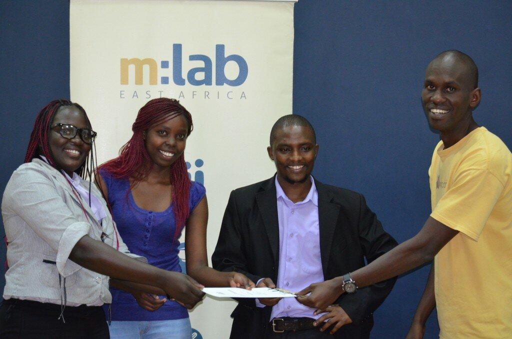 Josiah Mugambi Executive Director iHub awarding a certificate to Sokonect one of the winners of the Mobile Impact Ventures Program